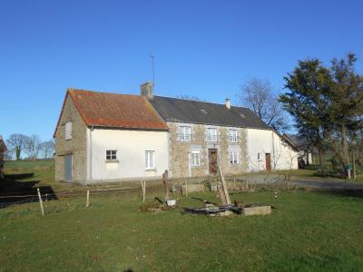 Farmhouse with Outbuildings and Lots of Land